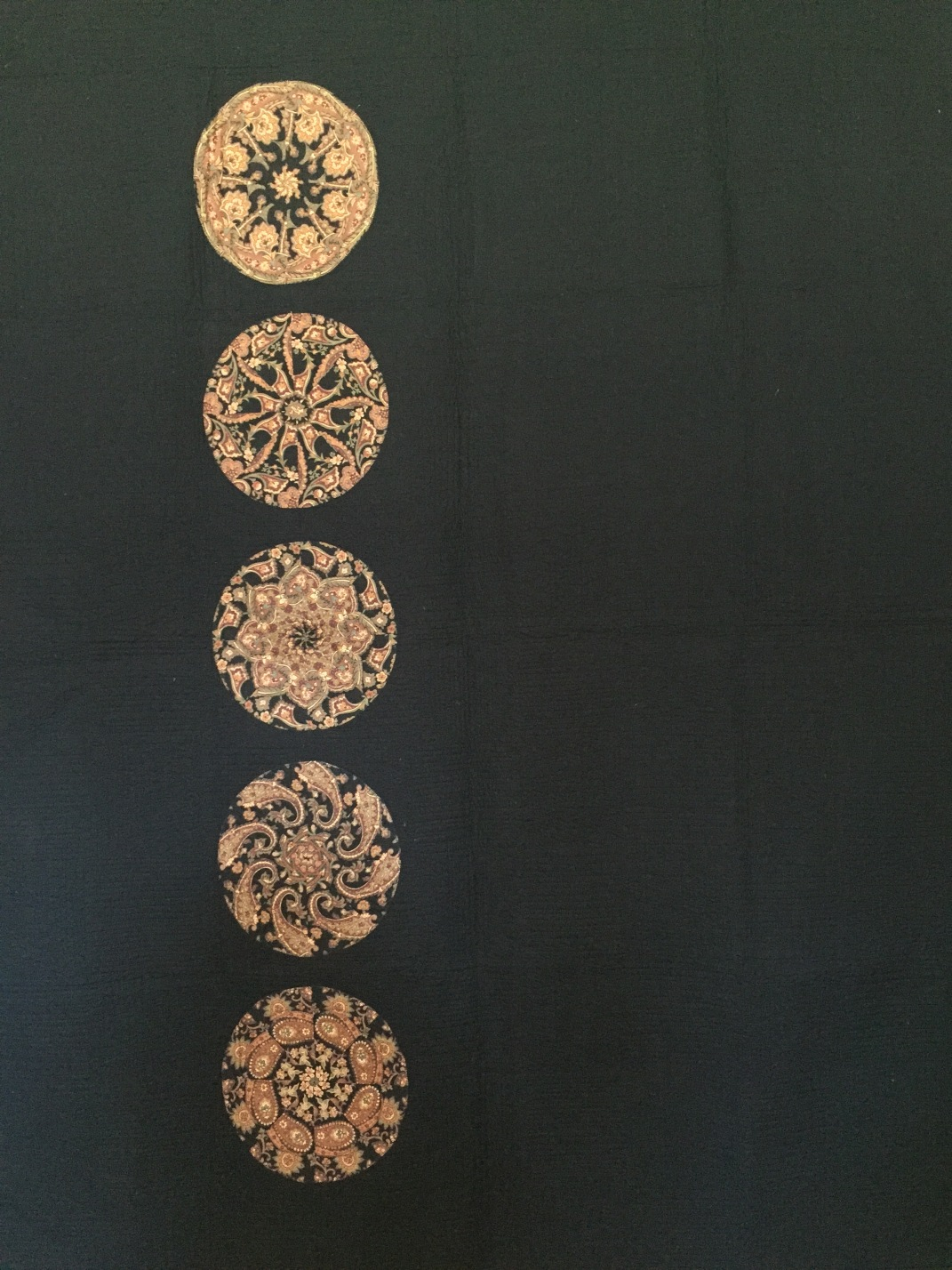 """63 x 80"""" $800 Applique with freehand custom long-arm quilting. Black batting."""
