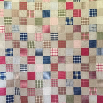 """82 x 88"""" $900 Freehand custom long-arm quilted with interlocking circles; homespun and micro-suede, with plaid flannel backing"""